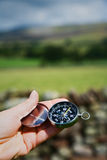 Hand Holding Compass in Rural Setting Stock Images
