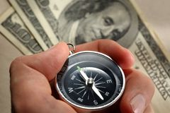 Hand holding compass Royalty Free Stock Images