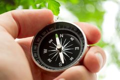 Hand holding compass Royalty Free Stock Photos