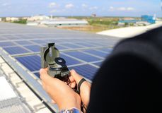Hand Holding Compass at Solar Rooftop System Importance of Direction Concept. Hand Holding Compass at Solar Rooftop System showing the Importance of Roof stock photos