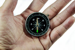 Hand Holding Compass on White. Business advisor holding compass. Over the shoulder view stock photos