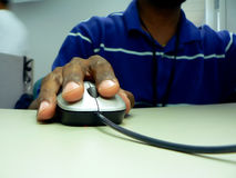 Hand holding computer mouse Royalty Free Stock Image