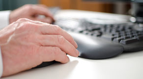 Hand holding a computer mouse Stock Images