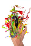 Hand holding a computer mouse with paint all around Stock Image