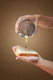 Hand holding condensed milk can Stock Photo