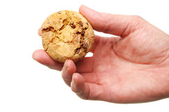 Hand holding a cookie Stock Photo
