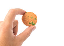 Hand holding cookie on white background. Stock Photo
