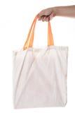 Hand holding cotton eco bag on white background Royalty Free Stock Photo