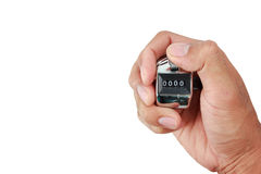 Hand holding a counter with zero number in the display isolated Royalty Free Stock Photos