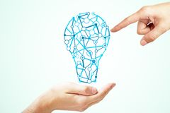 Idea and achieve concept. Hand holding creative light bulb sketch on subtle light background. Idea and achieve concept royalty free stock images