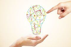 Idea and solution concept. Hand holding creative light bulb sketch on subtle light background. Idea and solution concept royalty free stock image