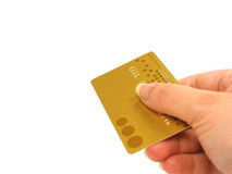 Hand holding credit card (clipping path included). Female hand holding a golden credit card with clipping path Stock Images