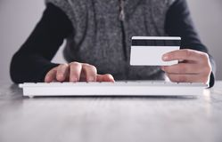 Hand holding credit card. Online shopping stock photos