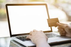 Hand holding credit card for online shopping on laptop ecommerce. Concept and finance Royalty Free Stock Photo