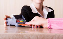 Hand holding credit card in payment terminal Stock Images