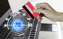 Hand holding credit card and using laptop with online shopping icons technology, Online shopping concept stock images