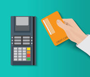 Hand holding credit card and using pos terminal. Fast payment. Royalty Free Stock Photography