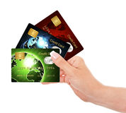 Hand holding credit cards isolated over white Stock Images