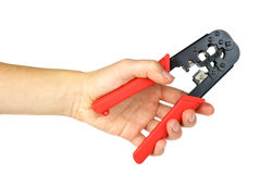 Hand holding crimping cutting tool Stock Photography