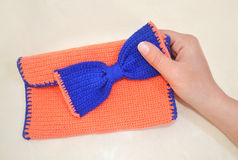 Hand holding a crochet bag Stock Images