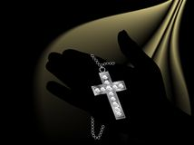 Hand holding the cross Royalty Free Stock Images