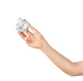 Hand holding crumpled paper ball Stock Image