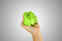 Hand holding crumpled paper with idea writing Royalty Free Stock Photos