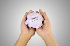 Hand holding crumpled paper with sales writing. Sales Concept. Human hand holding crumpled paper with sales writing royalty free stock images