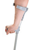 Hand holding crutch Stock Image