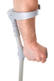 Hand holding crutch Stock Images