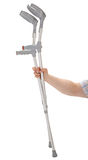 Hand holding crutches Stock Photo