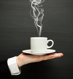 Hand holding cup Stock Photography