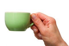 Hand holding a cup of coffee Royalty Free Stock Photos