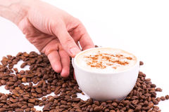 Hand holding a cup of coffee Stock Photo