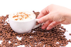 Hand holding a cup of coffee Royalty Free Stock Photography