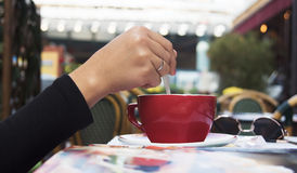 Hand holding cup of coffee Royalty Free Stock Photos