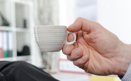 Hand holding a cup of coffee Royalty Free Stock Images