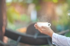 Hand holding  cup of coffee. Selective focus Stock Photo