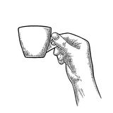 Hand holding a cup of coffee. Vintage black vector engraving Stock Photo