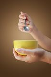Hand holding cup Stock Image