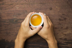 Hand holding cup of tea Royalty Free Stock Images