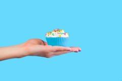 Hand holding cupcake Royalty Free Stock Image