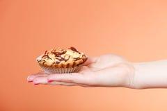 Hand holding cupcake decorated chocolate Stock Photo