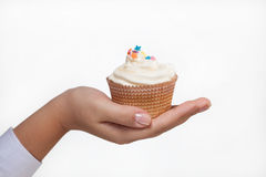 Hand holding a cupcake isolated on white Stock Images