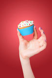 Hand holding cupcake Stock Photos