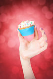 Hand holding cupcake Royalty Free Stock Photography