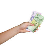 Hand holding currency on white background Stock Image