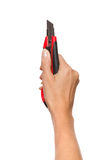 Hand Holding Cutter Stock Photography