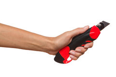 Hand Holding Cutter Stock Photo