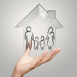 Hand holding 3d house wtih family icon Royalty Free Stock Images